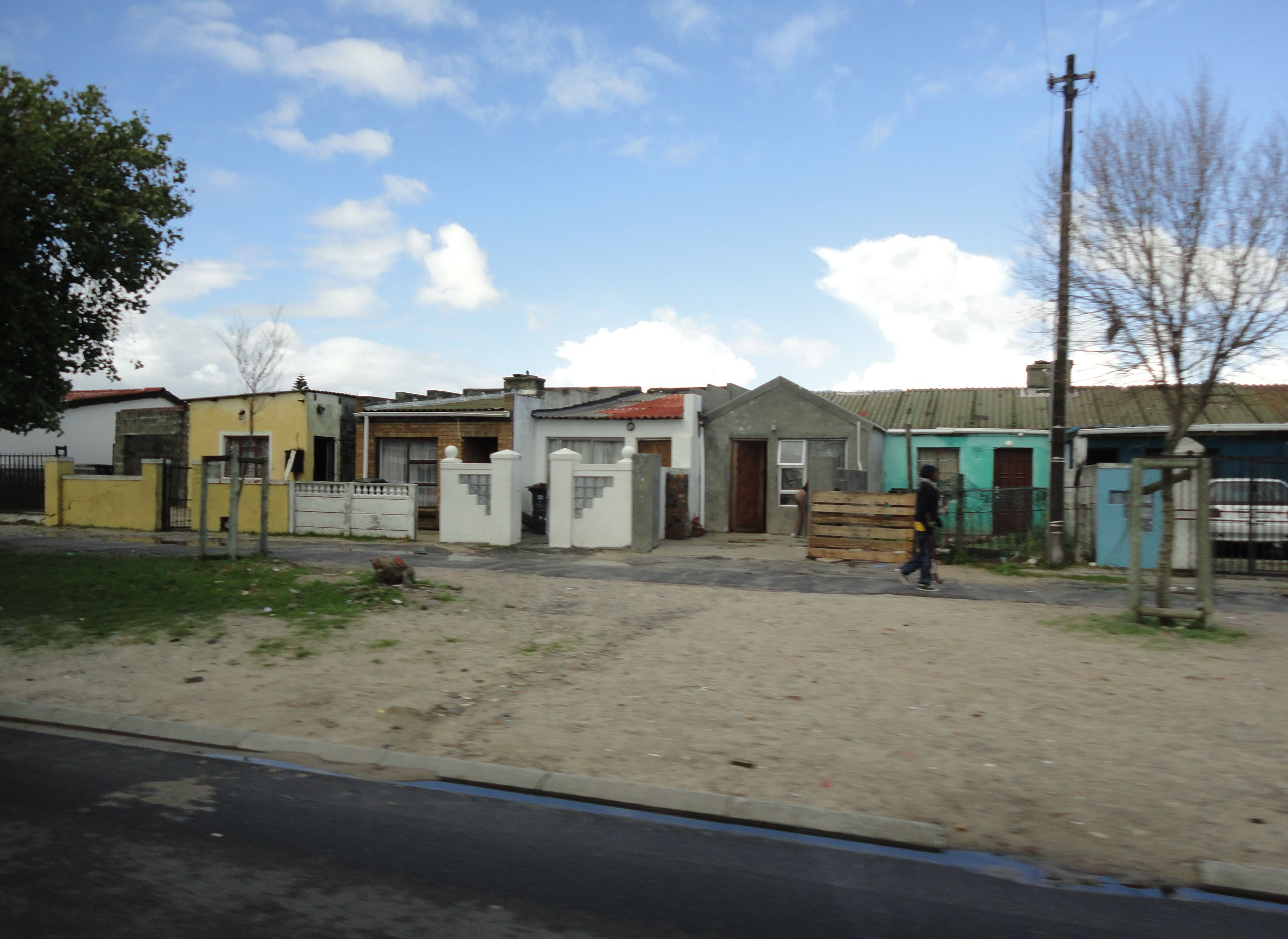 Some regular houses left and an apartment block by one of our stops both are in langa a black township